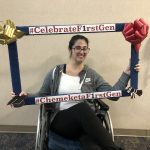 "A photo of a female Chemeketa student in a wheel chair holding a frame that reads ""Celebrate FirstGen"""